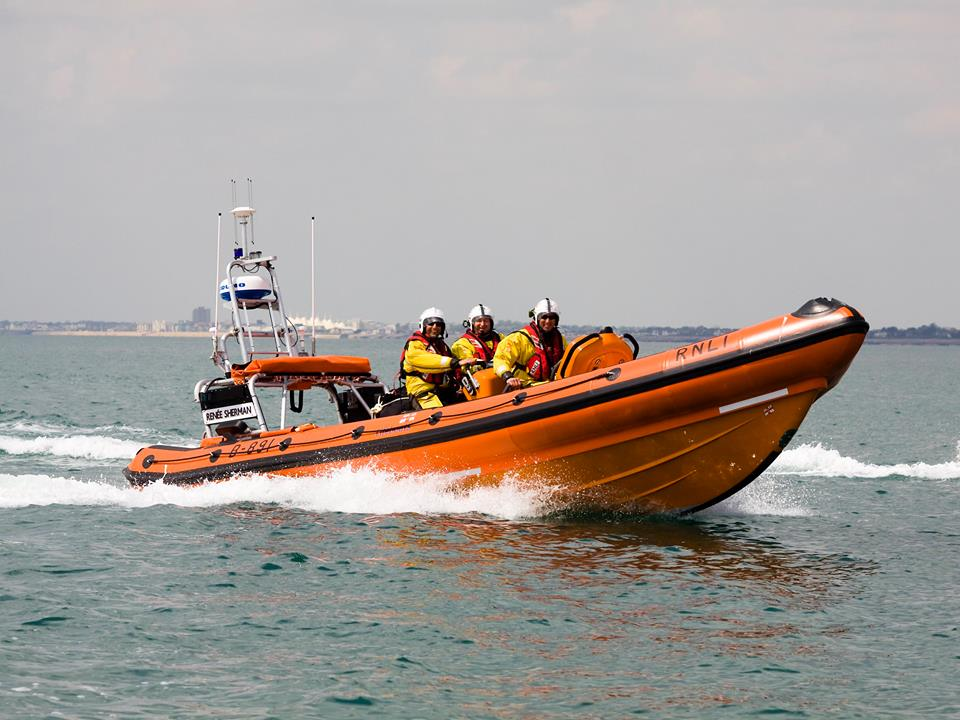 Seven rescued from sinking powerboat